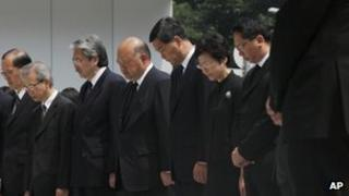 Hong Kong Chief Executive CY Leung (fifth from left) with officials mourning the boat crash victims, 4 October 2012