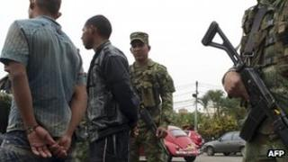 Demobilized Farc fighters escorted by troops, September 2012