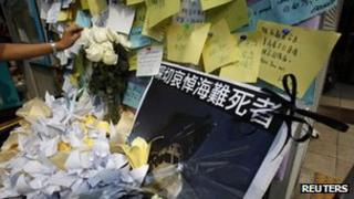 Flowers and notes left by mourners for those died in the 1 October ferry collision are seen at the Central Ferry Pier in Hong Kong, 4 Oct 2012