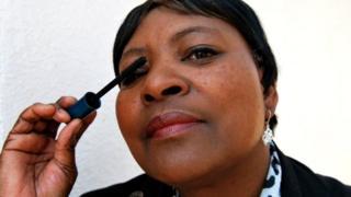 Maggy More applying Avon mascara