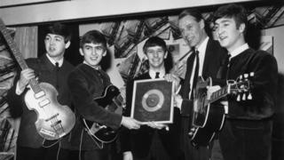 The Beatles with a silver disc in 1963