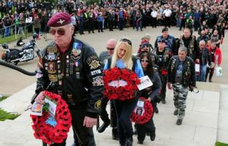 Bikers lay wreaths at the National Memorial Arboretum