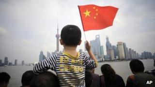 People stroll on the Bund, a famous waterfront in Shanghai, 03 Oct 2012