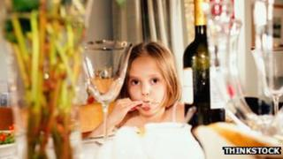 Girl among wine bottles