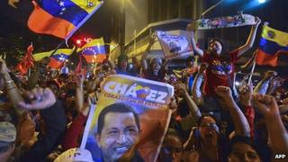 Supporters of Venezuelan President Hugo Chavez celebrate after receiving news of his re-election in Caracas (7 Oct)