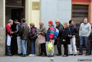 People line up outside the Ave Maria charity food centre in Madrid, November 2011