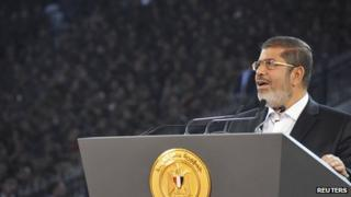 President Morsi addressing crowds in Cairo stadium, October 6, 2012.