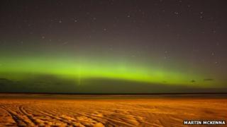 Aurora over beach