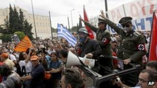 Protesters dresses as Nazis in Athens, Greece (9 Oct 2012)