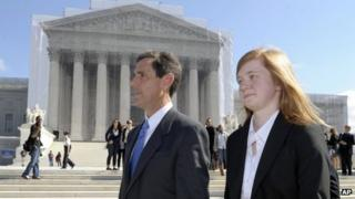 Abigail Fisher and Edward Blum walk in front of the US Supreme Court in Washington DC, 10 October 2012