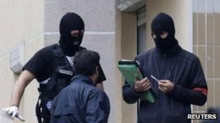 Masked police in Torcy, Paris