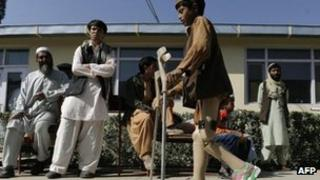 An Afghan child uses crutches as he learns to walk at The International Red Cross Centre (ICRC) in Kabul.
