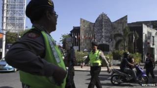 An Indonesian policeman stands guard at the 2002 Bali bombing memorial monument, ahead of the 10-year anniversary of the incident in Kuta, Bali resort island October 11, 2012