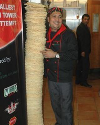 Tipu Rahman with his stack of poppadoms