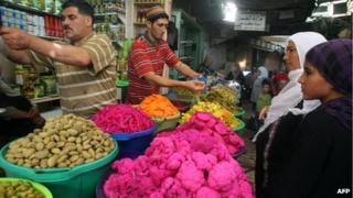 Market vendors at a stall in Hebron Old City