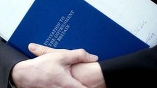 Someone holding the Conservative 2010 manifesto