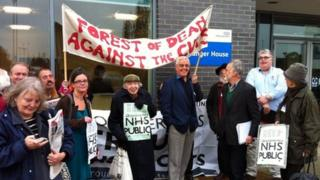 Campaigners gathered outside Gloucestershire NHS headquarters
