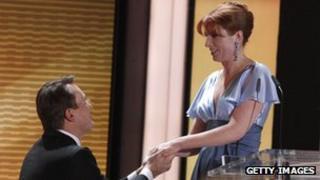 Rolf Hellgardt (left) former Kabel Eins head of programming accepts the proposal of marriage from his girlfriend former German TV presenter Monika Lierhaus