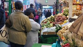 Browsing in Leeds Kirkgate Market