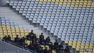 Riot police at an empty Borg El Arab stadium in Egypt (16 Sept 2012)