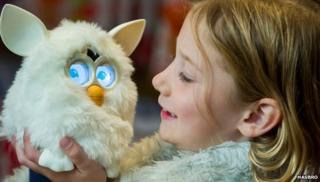 Furby held by a child