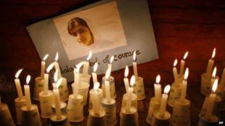 A picture of Malala and candles.