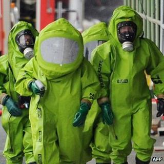 Firefighters in protective clothing deal with a chemical accident at a Kraft Foods factory in Bad Fallingbostel, northern Germany