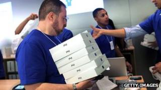 Apple store employee with iPads
