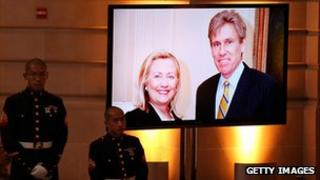 Image of Christopher Stevens with Hillary Clinton at his memorial service. 16 Oct 2012