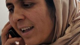 Afghanistan woman in hijab on mobile phone