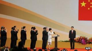 Hong Kong Chief Executive Leung Chun-ying (R) watches his cabinet members as they are sworn in during an inauguration ceremony in Hong Kong, 01 Jul 2012