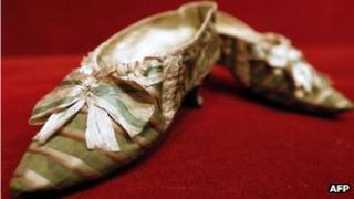 """A pair of shoes which belonged to French queen Marie Antoinette appear at Paris Drouot auction house as part of a sale of """"Historic memories of Royal Families"""""""