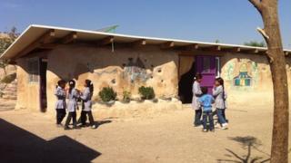Bedouin children are taught at Khan al-Ahmar school