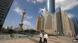 People walking through the financial district of Shanghai, 17 Oct 2012