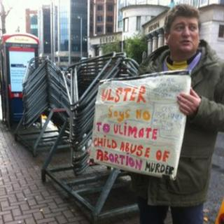 A protester outside the Marie Stopes clinic in Belfast