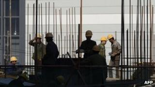 A group labourers work at a building site in Beijing, 18 Oct 2012