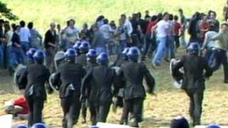 Striking miners and police in riot gear