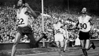 Arthur Wint (left), wins the Summer Olympic 400-metre dash at Wembley Stadium in England, leading his teammate Herb McKenley (right) who finished second