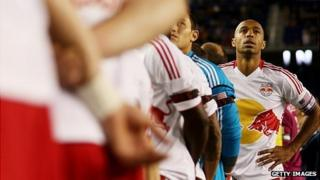 New York Red Bulls players take part in a tribute to murdered coach Mike Jones