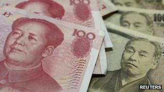 Chinese yuan and Japanese yen banknotes