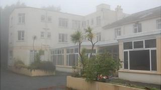 Former St Martin's Hotel in Guernsey, surrounded by mist