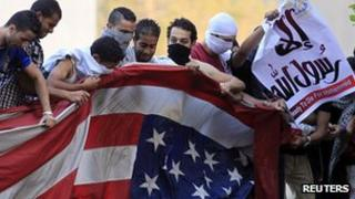 Protester in Cairo destroy US flag. 11 Sept 2012