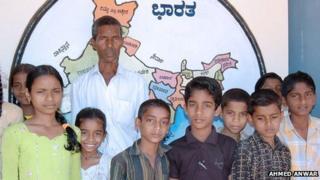 Harekala Hajabba and the young pupils