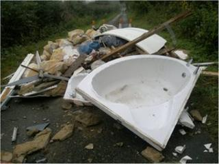 flytipped waste in road