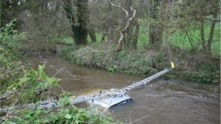 The car pictured in the water