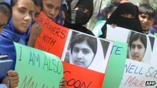 Pakistani students carry placards with the photograph of child activist Malala Yousafzai