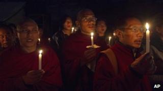 Exiled Tibetan monks hold a vigil
