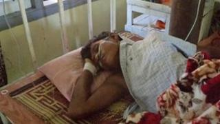 A Buddhist victim of the violence recovers in hospital
