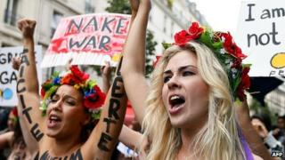 Topless activists from Ukraine's Femen group protest in Paris