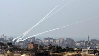 A trail of smoke is seen as a rocket is launched from the Palestinian Gaza Strip towards southern Israel